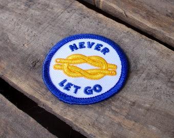 Never Let Go Embroidered Merit Badge