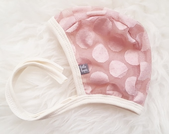 Blush Dot lace pilot hat by Little Lapsi. Baby hat with ties. modern hearing aid
