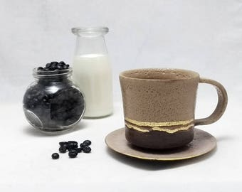 Coffe or tea cup with  (medium-sized). Handmade contemporary ceramics