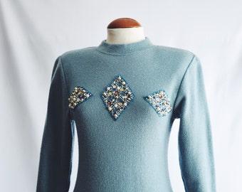 Blue sweater dress with rhinestones.
