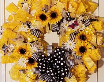A Splash of Sunshine is a Yellow and Black Wreath, with Sunflowers and White Daisies.  Made with Burlap Deco Mesh. Spring, Summer Wreath
