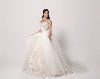 Ball-Gown Tulle wedding dress with Skin-toned Corset and Long Train
