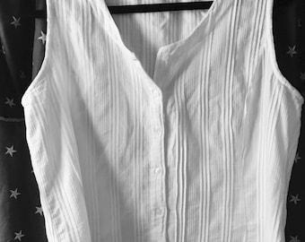White lovely cotton sleeveless blouse