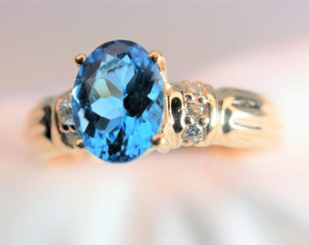 A very royal looking blue topaz and 6 diamond ring