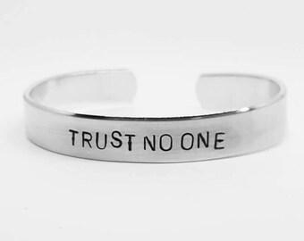 trust no one: hand stamped aluminum X-Files fandom cuff bracelet