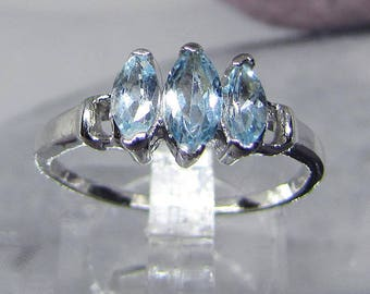 Blue Topaz on size 50 silver band ring