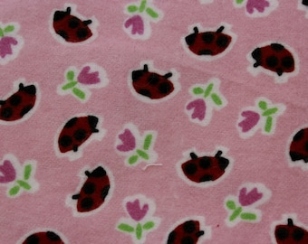 """Marcus Brothers Ladybugs on Pink  100% cotton flannel  41""""-44"""" wide"""