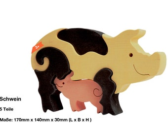 Wooden puzzle pig with piglet