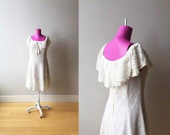 The Winona 1990s White Lace Poet Dress