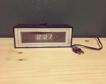 Vintage black GE flip clock.