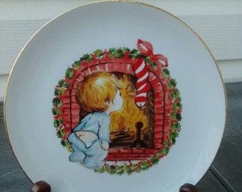 Vintage 1982 JASCO Xmas Plate, White Porcelain, Gold Trim, Boy in Pajamas Looking for Santa in Fireplace.