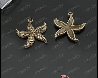 10 charms 23MM brass star sea D22880
