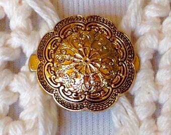 The mattie antiqued gold tone plastic medallion sweater clip brooch