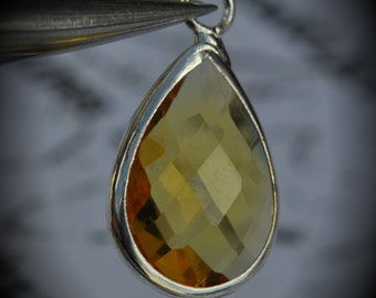 Silver Plated Bezel Brass Faceted Glass Tear Drop Pendant - Topaz