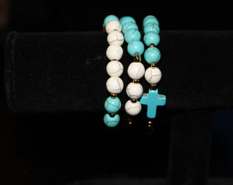 Turquoise, cross, and gold bracelet set