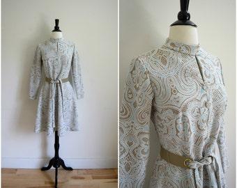 Vintage mod paisley long sleeve mini dress / belted high neck retro dress / blue, white and tan gogo girl dress