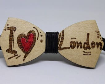 Papillon wood with engraving. Choose the name of your city