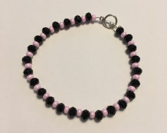 Black and pink delicate style bracelet