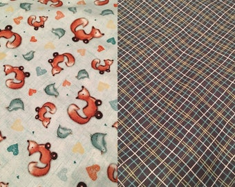 25 inch roller foxes with dark blue plaid around the neck tie on bandana