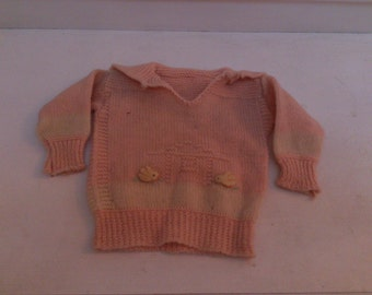 Vintage knit baby sweater with birds and house