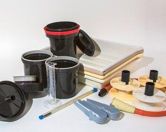 Darkroom equipment - forceps, thermometer, developing tanks, trays, measuring jug