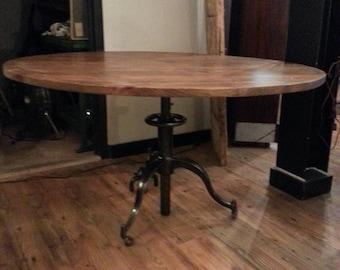 Vintage industrial adjustable round dining table.