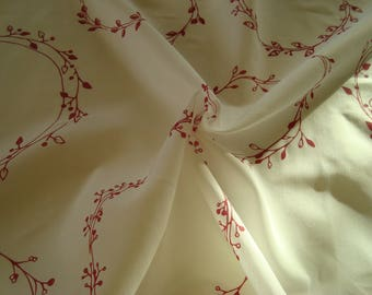 Fabric type printed sheer red on white background