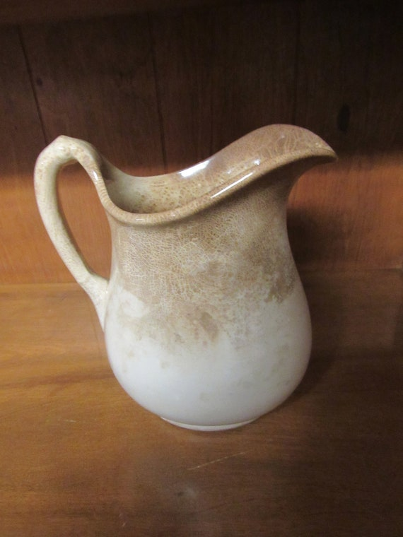 Antique brown and white pitcher