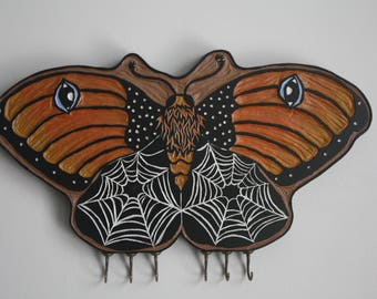 Moth with Webs