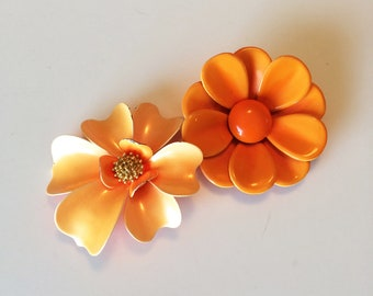 Two pretty vintage orange floral brooches perfect for spring