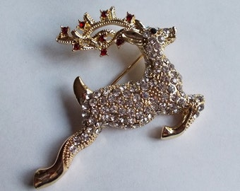 Monet White and Red Crystal Flying Reindeer Holiday Brooch