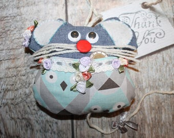 Small cushion mouse to tooth fabrics look blue jeans and owls