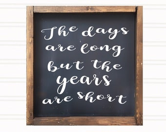 Days are long but the years are short wooden sign