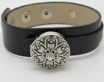 BLACK LEATHER WITH CENTRAL MOTIF CUFF BRACELET