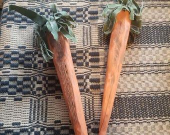 Primitive wooden carrots