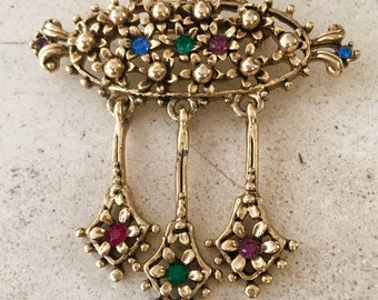 Estate Vintage Gold toned Brooch with Glass Stones and Moving Pendulum Pieces. Excellent Condition.