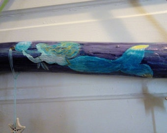 Hand mermaid on drift wood with sea glass