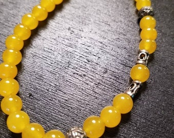 Yellow jade bead wire-strung necklace with Bali bead accents