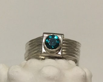 Silver hammered ring with green topaz