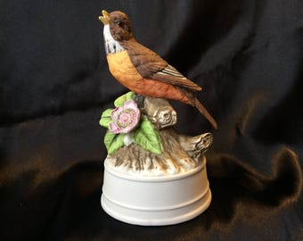 Royal Crown porcelain bisque American Robin figurine with flower