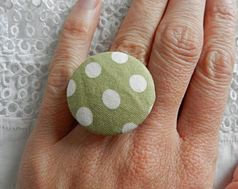 Adjustable ring in lime green cloth with white polka dots