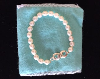 LIKE NEW!!  Stunning Tiffany & Co White Pearl and Sterling Silver Infinity Bracelet