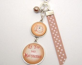 Maîtresse , porte-clés bijou de sac a message  le top des maîtresses orange.REF.126