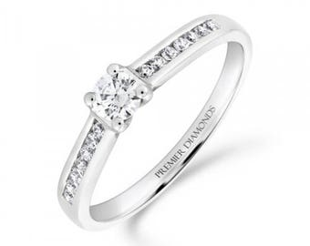 Stunning round brilliant cut four claw solitaire diamond engagement ring, with channel set diamond shoulders 0.50 carat