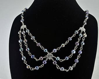 Black peacock freshwater pearl bib sterling silver necklace