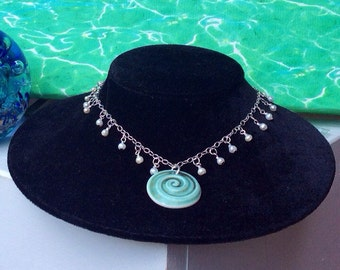 Infinity pearl and bisque necklace (with matching earrings).