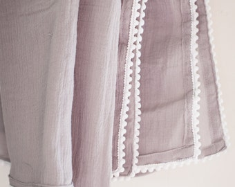 Gray muslin receiving blanket with white trim