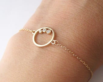 Bracelet 750/000 small zirconium CZ and 18 k gold plated circle