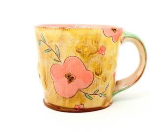 Puffy Floral Earthenware mug. Wheel thrown, food safe mug made by Kaitlyn Brennan / Brennan Pottery