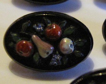 "1 1900's hand made black glass buttons. Raised fruit design. Highly sought after.  20 mm or 8/10"" diameter stock ref 1301"